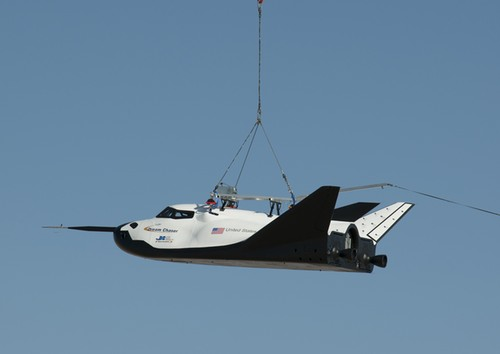 Dream Chaser performs a captive carry flight above Edwards AFB in California in August, suspended under a helicopter. (credit: NASA/Carla Thomas)